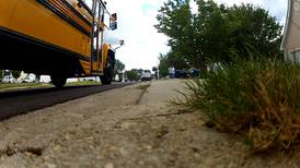 Gwinnett County school buses taking lunch to students learning virtually