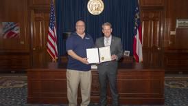 95.5 WSB's Kirk Mellish receives Gubernatorial Commendation from Gov. Kemp