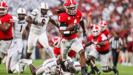 No. 2 Bulldogs rout Gamecocks 40-13 to open conference play